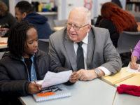 Volunteer helps student with homework
