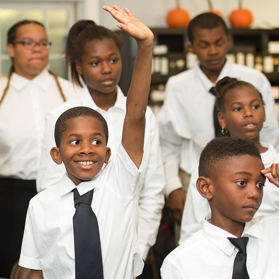 student raising hand in rehearsal