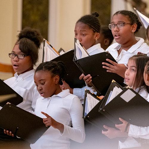 children singing at concert